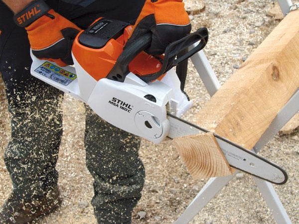 Stihl Battery Chainsaw MSA 160 cutting a block